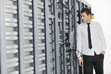 young handsome business man it  engeneer in datacenter server room Stock Photo - 8767781
