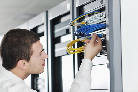 service providers: young handsome business man it  engeneer in datacenter server room