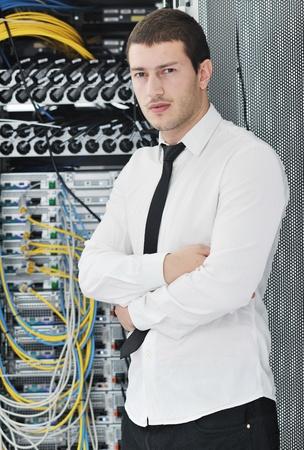 engeneer: young handsome business man it  engeneer in datacenter server room