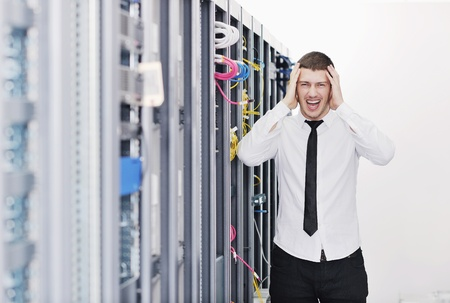 young handsome business man it  engeneer in datacenter server room Stock Photo - 8759718