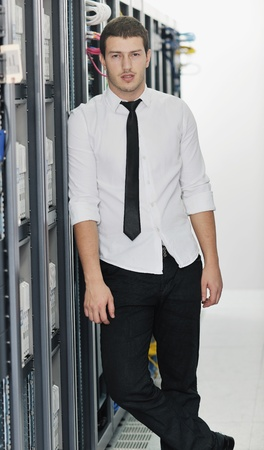 young handsome business man it  engeneer in datacenter server room Stock Photo - 8767774