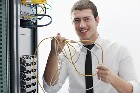 young handsome business man it  engeneer in datacenter server room Stock Photo - 8772688