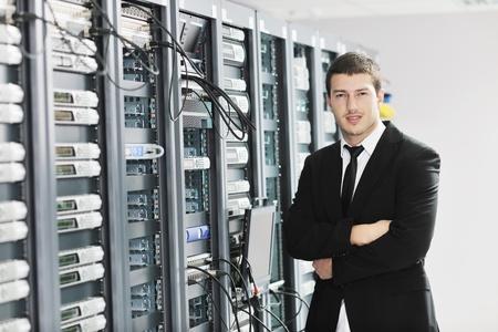 young handsome business man it  engeneer in datacenter server room Stock Photo - 8778202