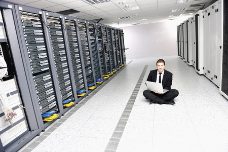 young it  engeneer business man with thin modern aluminium laptop in network server room Stock Photo - 8759959