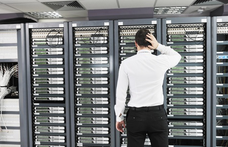 control center: it business man in network server room have problems and looking for  disaster situation  solution