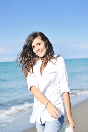 happy young woman relax onbeautiful  beach at morning Stock Photo - 8767916