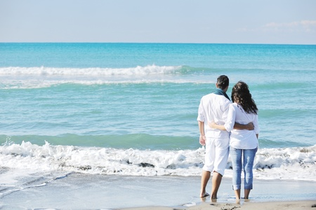 young love: happy young couple in white clothing  have romantic recreation and   fun at beautiful beach on  vacations Stock Photo