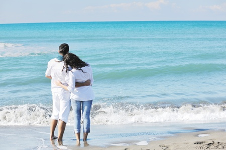 romance couple: happy young couple in white clothing  have romantic recreation and   fun at beautiful beach on  vacations Stock Photo