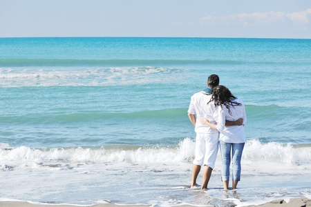 happy young couple in white clothing  have romantic recreation and   fun at beautiful beach on  vacations Stock Photo - 8777146