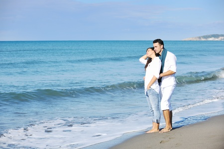 happy young couple in white clothing  have romantic recreation and   fun at beautiful beach on  vacations Stock Photo - 8777155