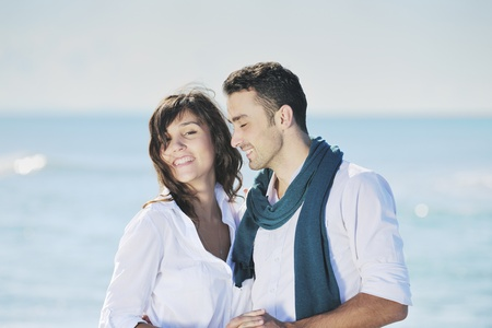 happy young couple in white clothing  have romantic recreation and   fun at beautiful beach on  vacations Stock Photo - 8777148