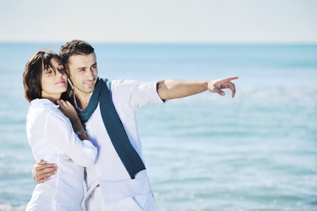 happy young couple in white clothing  have romantic recreation and   fun at beautiful beach on  vacations Stock Photo - 8767913