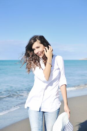 happy young woman relax onbeautiful  beach at morning photo