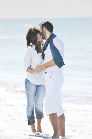 happy young couple in white clothing  have romantic recreation and   fun at beautiful beach on  vacations Banco de Imagens
