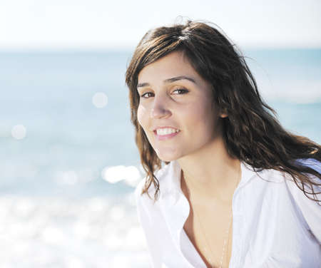 happy young woman relax onbeautiful  beach at morning Stock Photo - 8773313