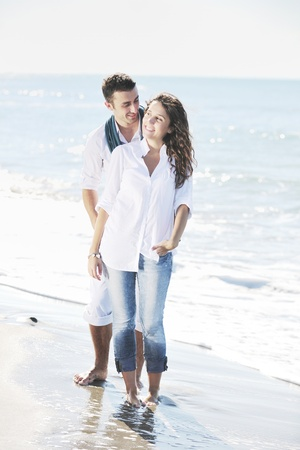 happy young couple in white clothing  have romantic recreation and   fun at beautiful beach on  vacations Stock Photo - 8768058