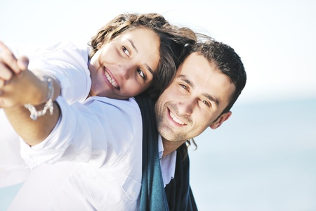 perfect: happy young couple in white clothing  have romantic recreation and   fun at beautiful beach on  vacations Stock Photo
