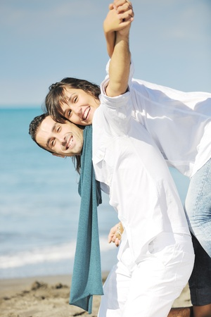 happy young couple in white clothing  have romantic recreation and   fun at beautiful beach on  vacations Stock Photo - 8777296