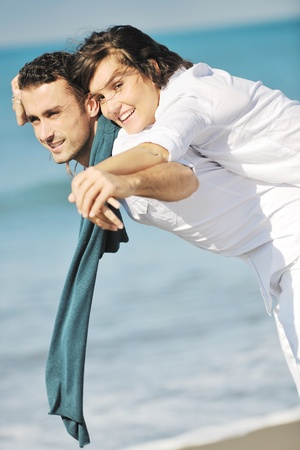 happy young couple in white clothing  have romantic recreation and   fun at beautiful beach on  vacations Stock Photo - 8768060