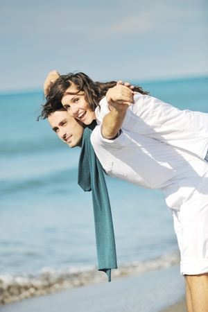 happy young couple in white clothing  have romantic recreation and   fun at beautiful beach on  vacations Stock Photo - 8773328