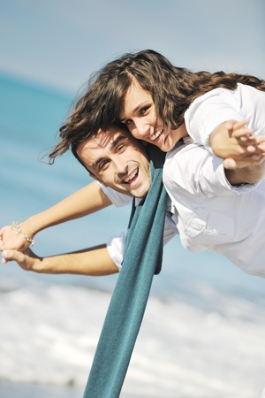 romantic sky: happy young couple in white clothing  have romantic recreation and   fun at beautiful beach on  vacations Stock Photo