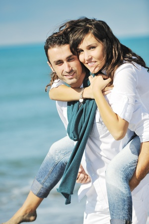 happy young couple in white clothing  have romantic recreation and   fun at beautiful beach on  vacations Stock Photo - 8773497