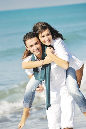 happy young couple in white clothing  have romantic recreation and   fun at beautiful beach on  vacations Stock Photo - 8777290