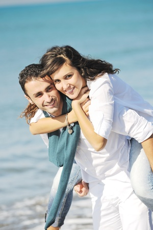 happy young couple in white clothing  have romantic recreation and   fun at beautiful beach on  vacations Stock Photo - 8777314