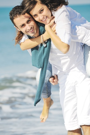 boyfriends: happy young couple in white clothing  have romantic recreation and   fun at beautiful beach on  vacations Stock Photo