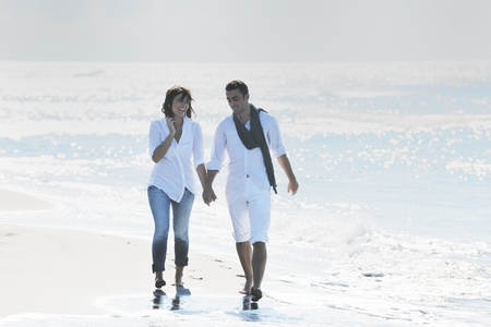 happy young couple in white clothing  have romantic recreation and   fun at beautiful beach on  vacations Stock Photo - 8768148