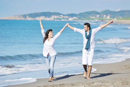 happy young couple in white clothing  have romantic recreation and   fun at beautiful beach on  vacations Stock Photo - 8768780