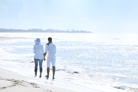 happy young couple in white clothing  have romantic recreation and   fun at beautiful beach on  vacations Stock Photo - 8773442