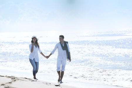 man on beach: happy young couple in white clothing  have romantic recreation and   fun at beautiful beach on  vacations Stock Photo