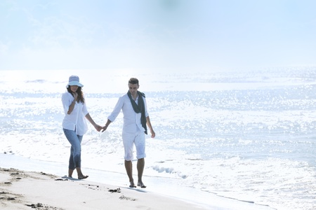 happy young couple in white clothing  have romantic recreation and   fun at beautiful beach on  vacations Stock Photo - 8773449
