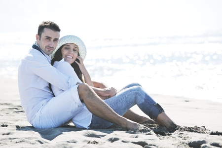 boyfriend: happy young couple in white clothing  have romantic recreation and   fun at beautiful beach on  vacations Stock Photo