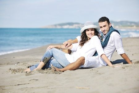 happy young couple in white clothing  have romantic recreation and   fun at beautiful beach on  vacations Stock Photo - 8778471