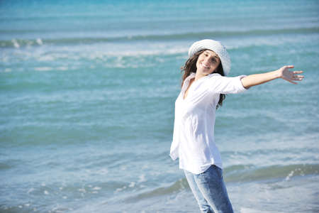 happy young woman relax onbeautiful  beach at morning Stock Photo - 8768425