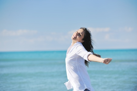 woman freedom: happy young woman relax onbeautiful  beach at morning Stock Photo
