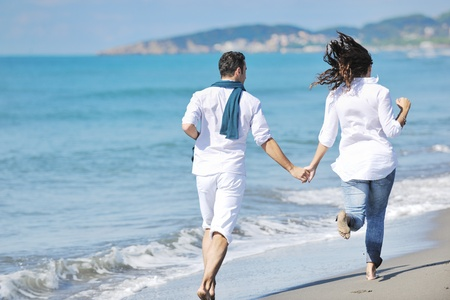 couple in summer: happy young couple in white clothing  have romantic recreation and   fun at beautiful beach on  vacations Stock Photo