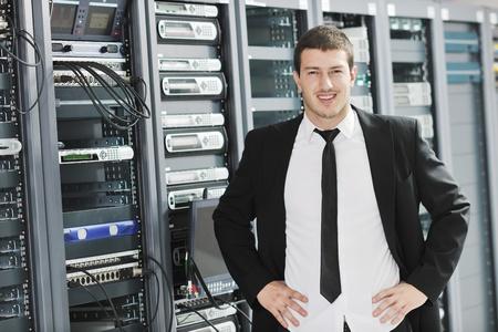 young handsome business man it  engeneer in datacenter server room Stock Photo - 8773895