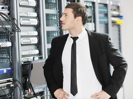 young handsome business man it  engeneer in datacenter server room photo