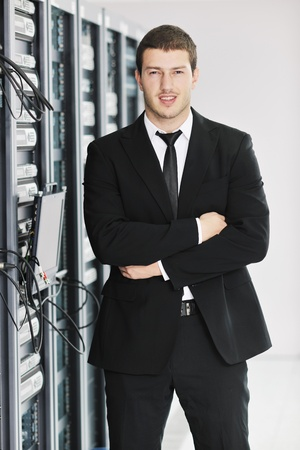 young handsome business man it  engeneer in datacenter server room photo