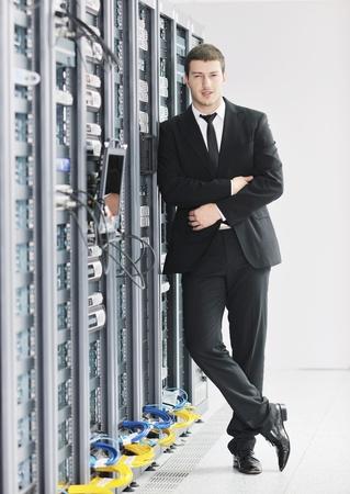 young handsome business man it  engeneer in datacenter server room Stock Photo - 8769086
