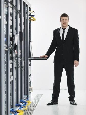 young handsome business man it  engeneer in datacenter server room Stock Photo - 8773444