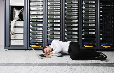 it business man in network server room have problems and looking for  disaster situation  solution Stock Photo - 8773883