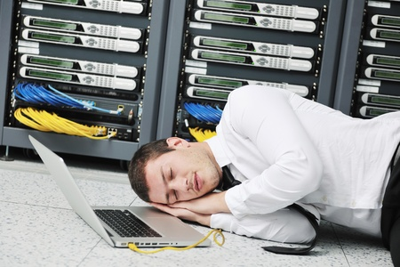 control centre: it business man in network server room have problems and looking for  disaster situation  solution