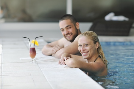 happy young couple on wellness and spa beauty treatment in bath and bed photo