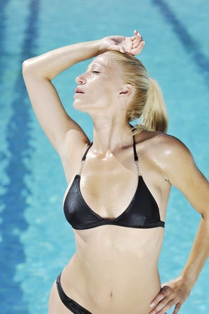 beautiful young woman relax and have fun at swimming pool photo