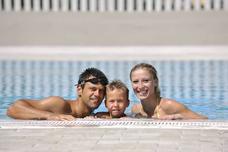 happy young family have fun on swimming pool  at summer vacation Stock Photo - 8882306