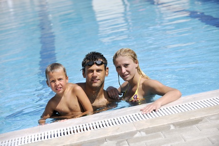 happy young family have fun on swimming pool  at summer vacation Stock Photo - 8882367